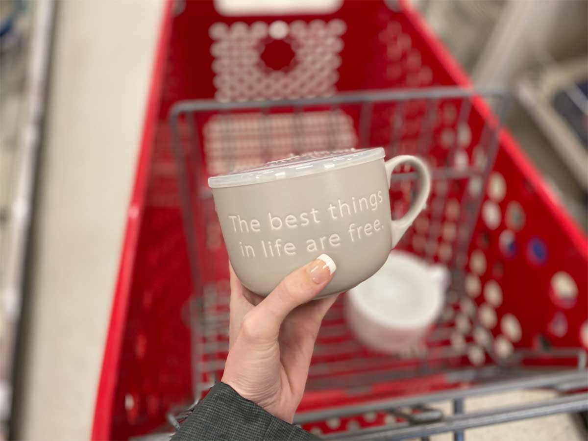 the best things in life are free mug with lid in-hand