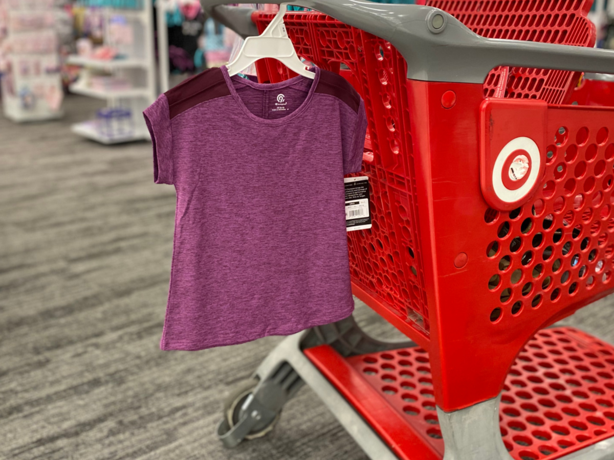 purple shirt hanging from target cart with blurry background
