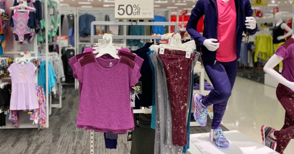 pink shirt and pink workout pants hanging on target rack