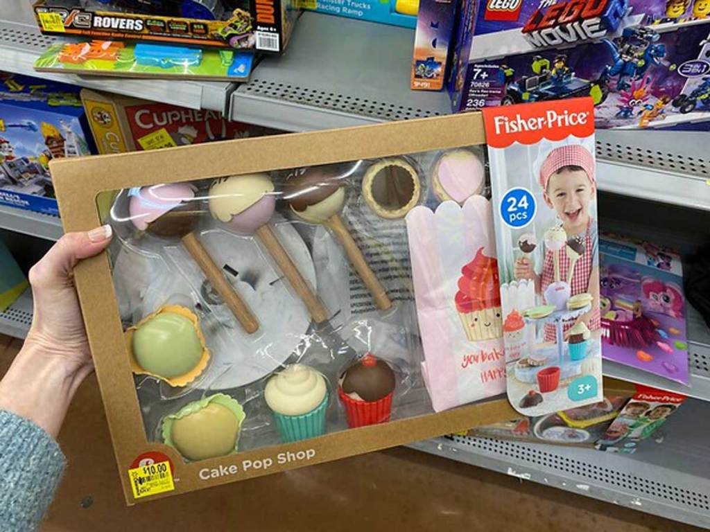 hand holding fisher price cake pop shop