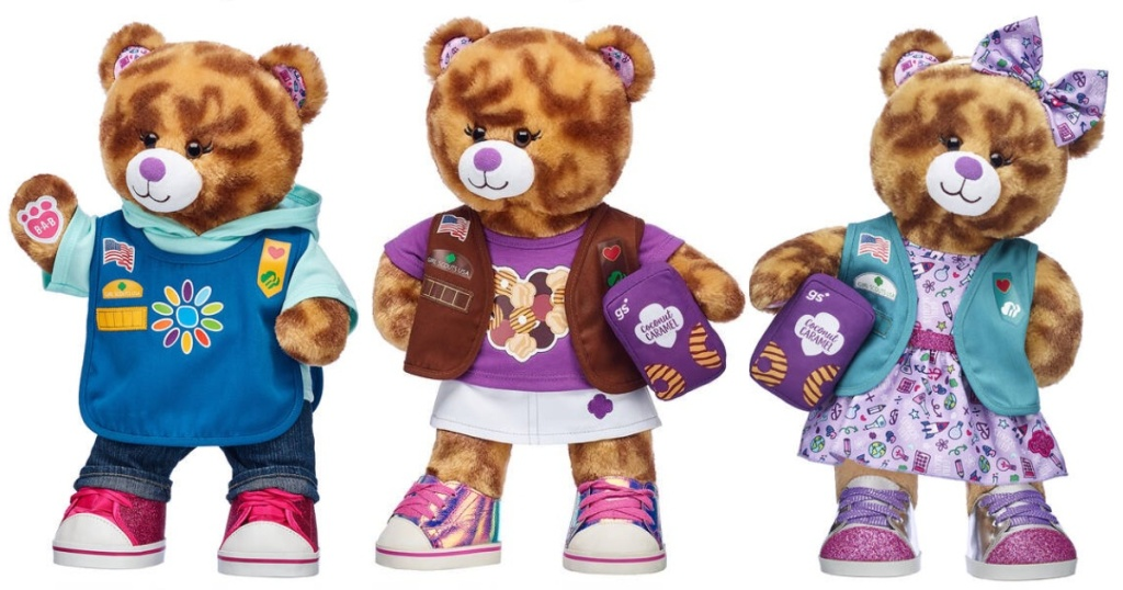 Caramel Cookie bear wearing 3 different Girl Scout uniforms