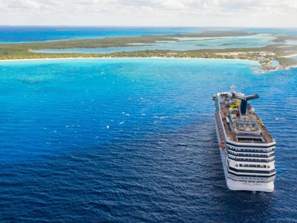 cruise ship moving toward island