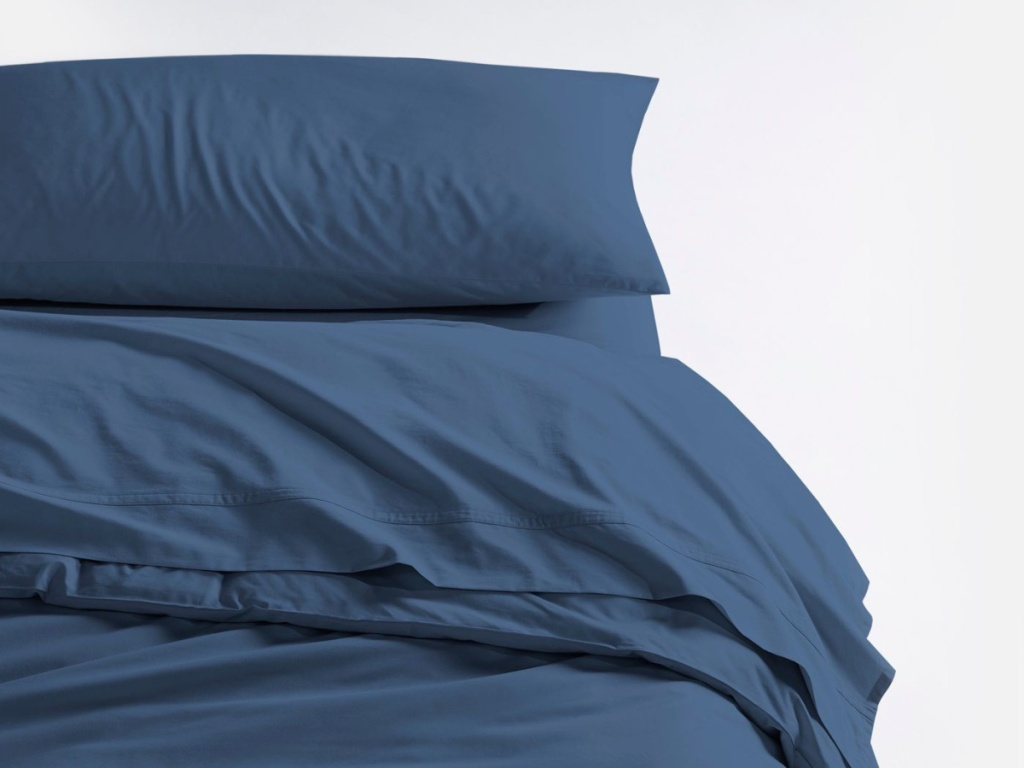 navy sheets and pillow case on bed
