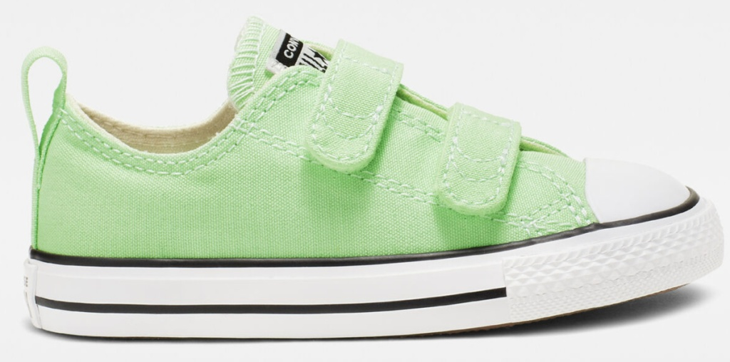 green converse shoes with white and blue soles