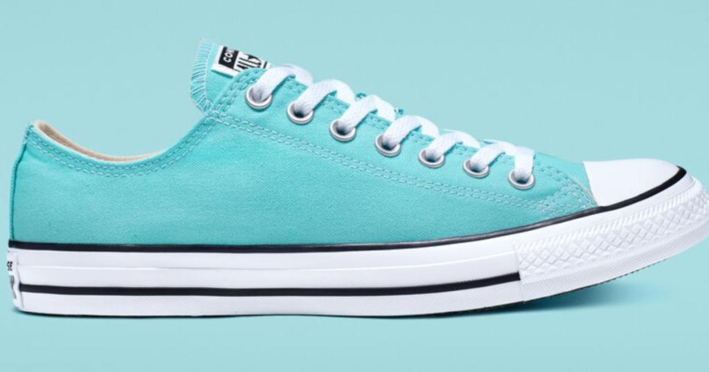 blue chuck taylor all star shoes with blue background