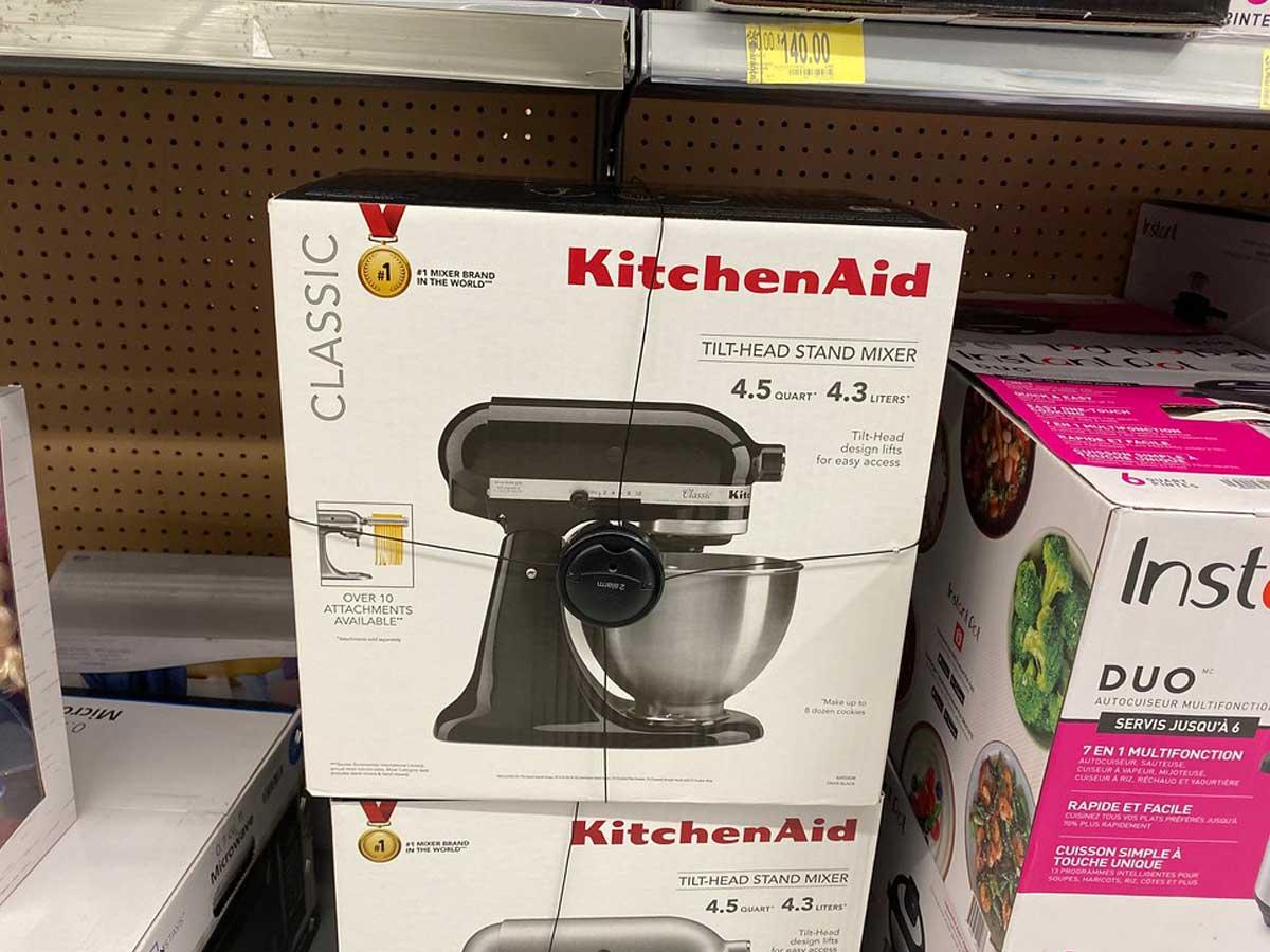 KitchenAid Classic Series Tilt-Head 4.5 Quart Onyx Black Stand Mixer on a shelf at store