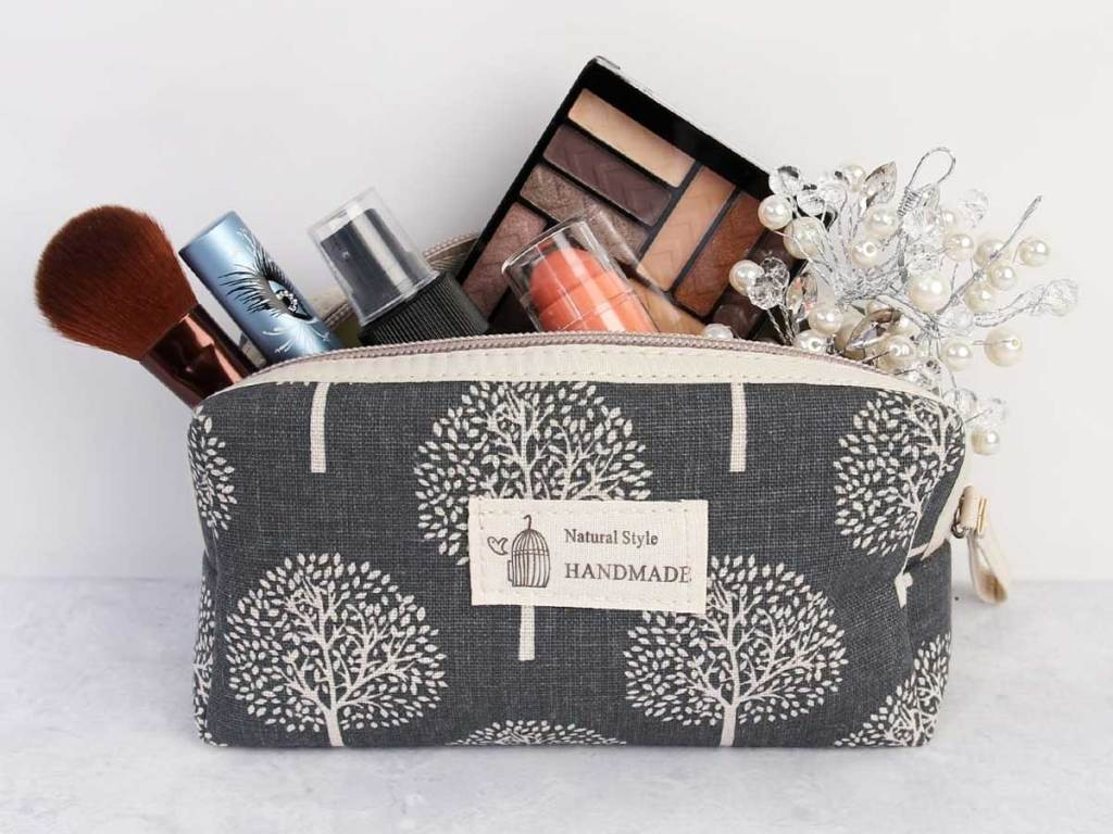 handmade cosmetic bag with makeup and brushes