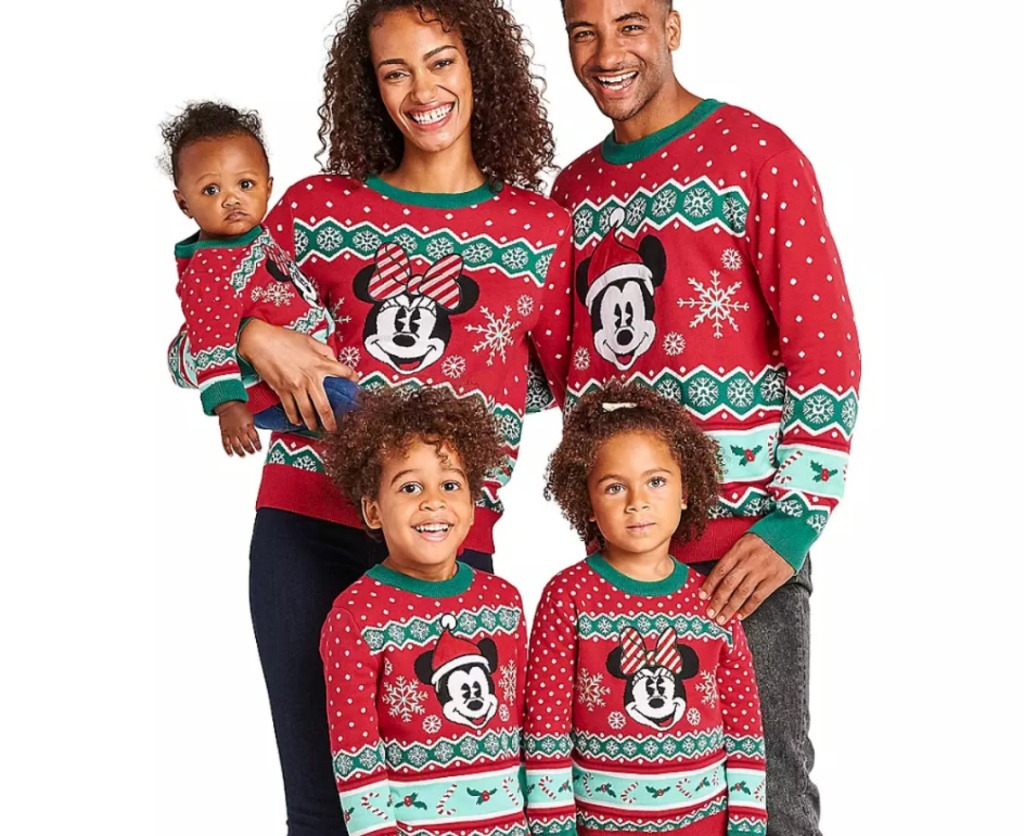 family wearing disney ugly Christmas sweaters