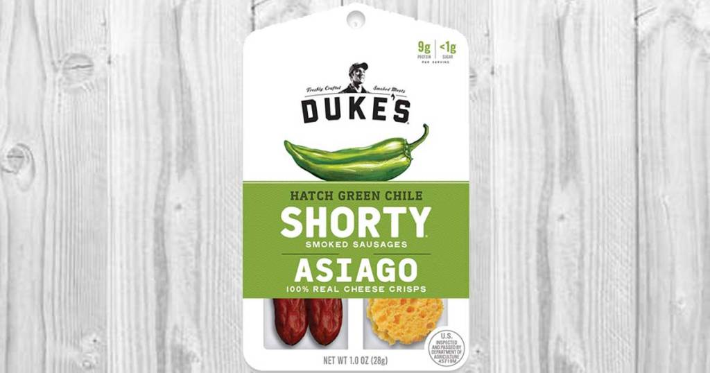 stock image of 12-count Dukes Shorty & Asiago Cheese Hatch Green Chile Snacks on wood background