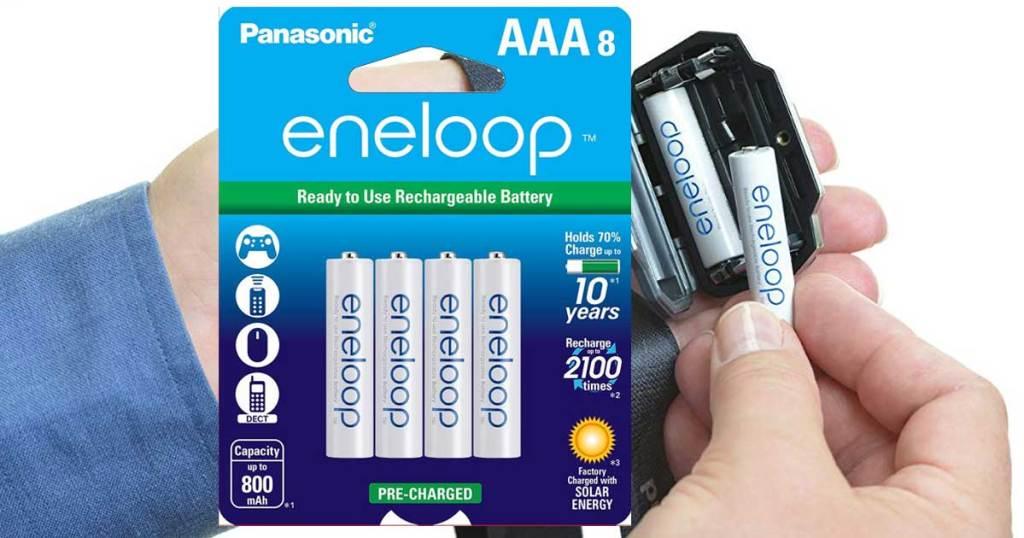 hand holding eneloop batteries