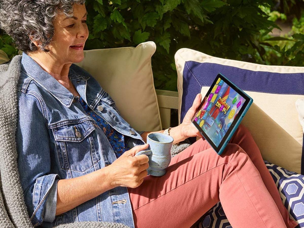 woman using Fire HD tablet