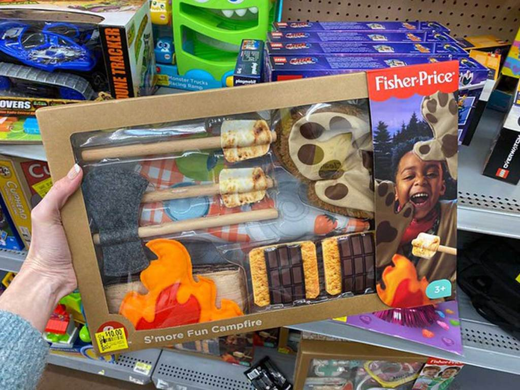 hand holding Fisher-Price S'more Fun Campfire in a store
