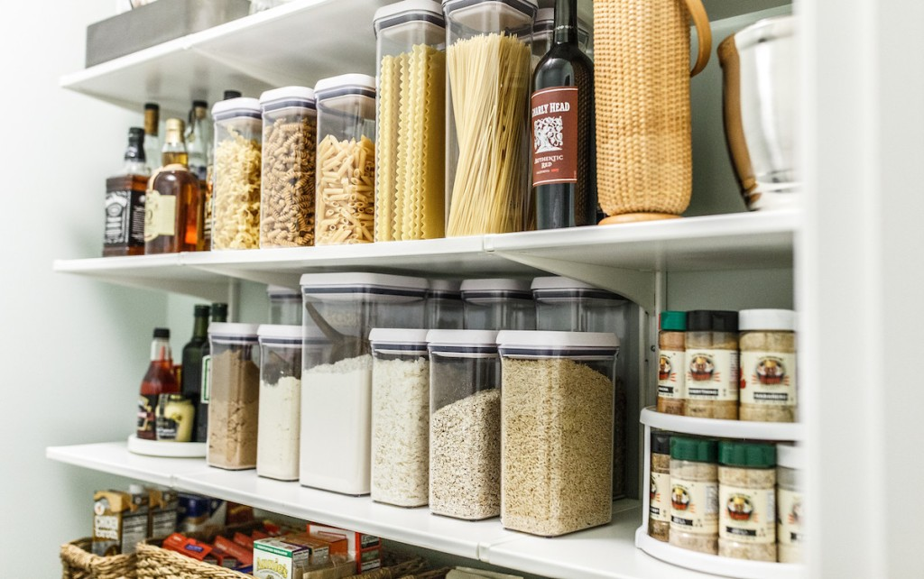 organized pantry with food containers and spices