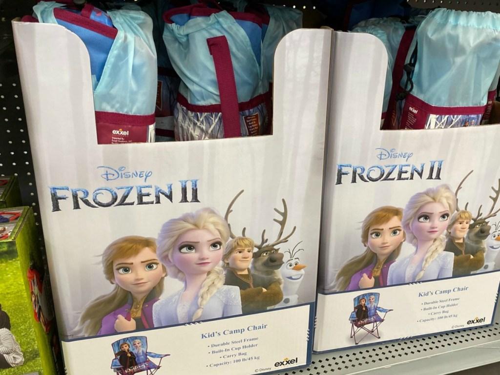 box full of kids camping chairs on store shelf