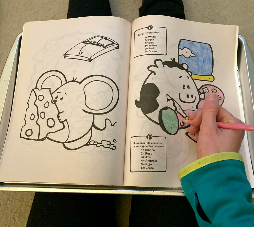 girl coloring on coloring book