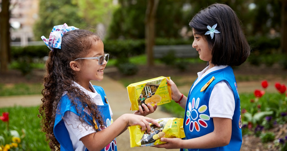 two Girl Scouts with lemon cookies