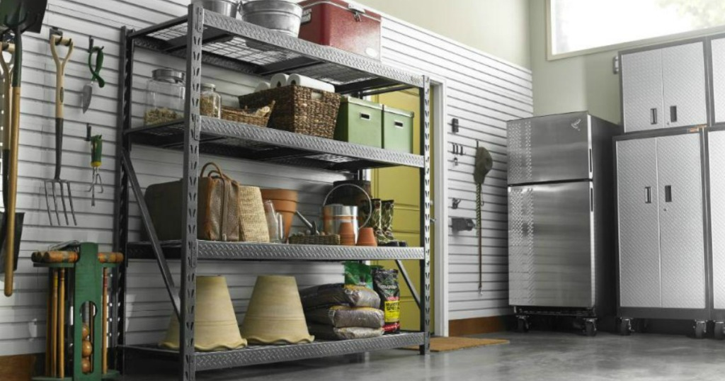 view of garage with gladiator 4 shelf steel unit with many items on it