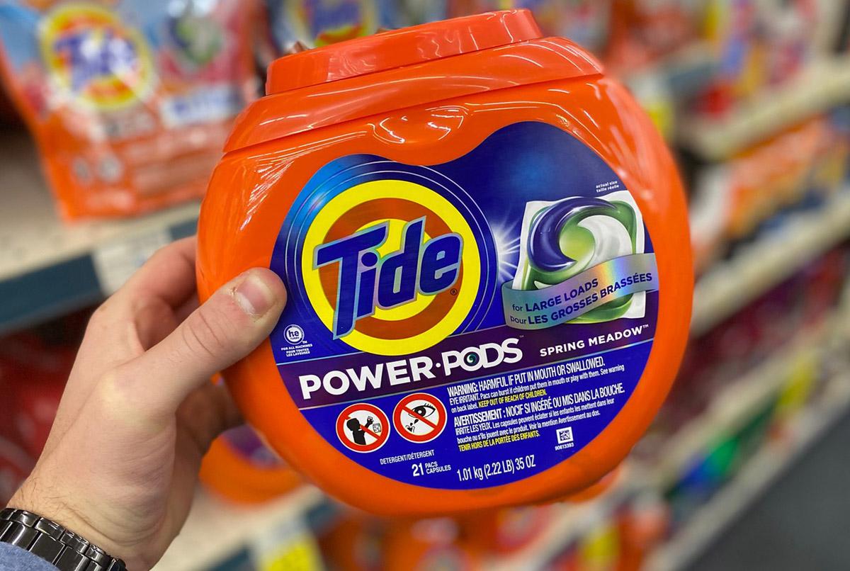 hand holding tide power pods cvs