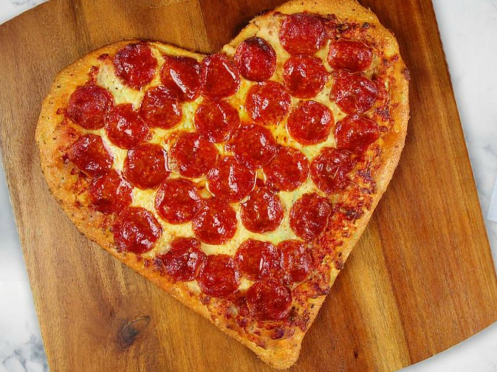 pepperoni pizza in the shape of a heart