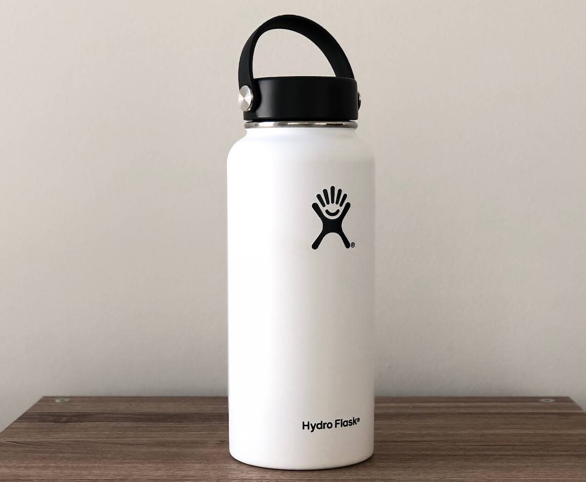 white hydro flask bottle sitting on table