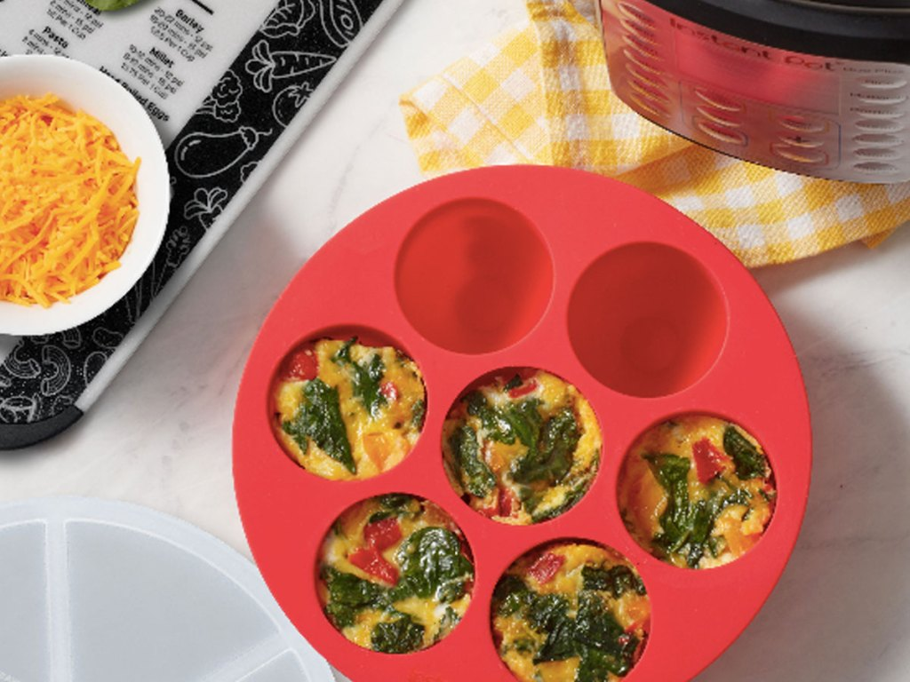 Instant Pot Official Silicone Egg Bites Pan With Lid with mini omelets made up on a counter in a kitchen