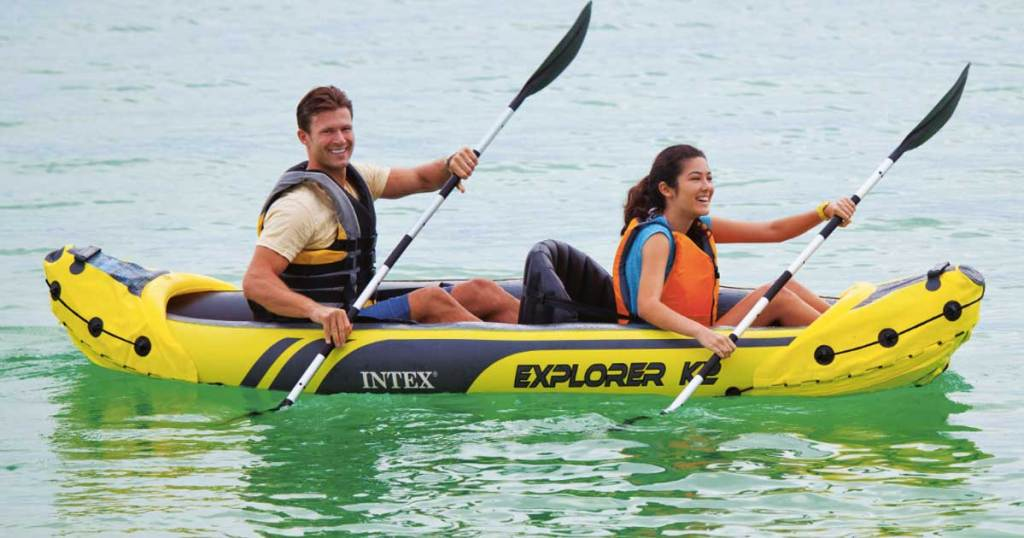 two people on an intex Explorer K2 Inflatable Kayak with Oars and Hand Pump on water