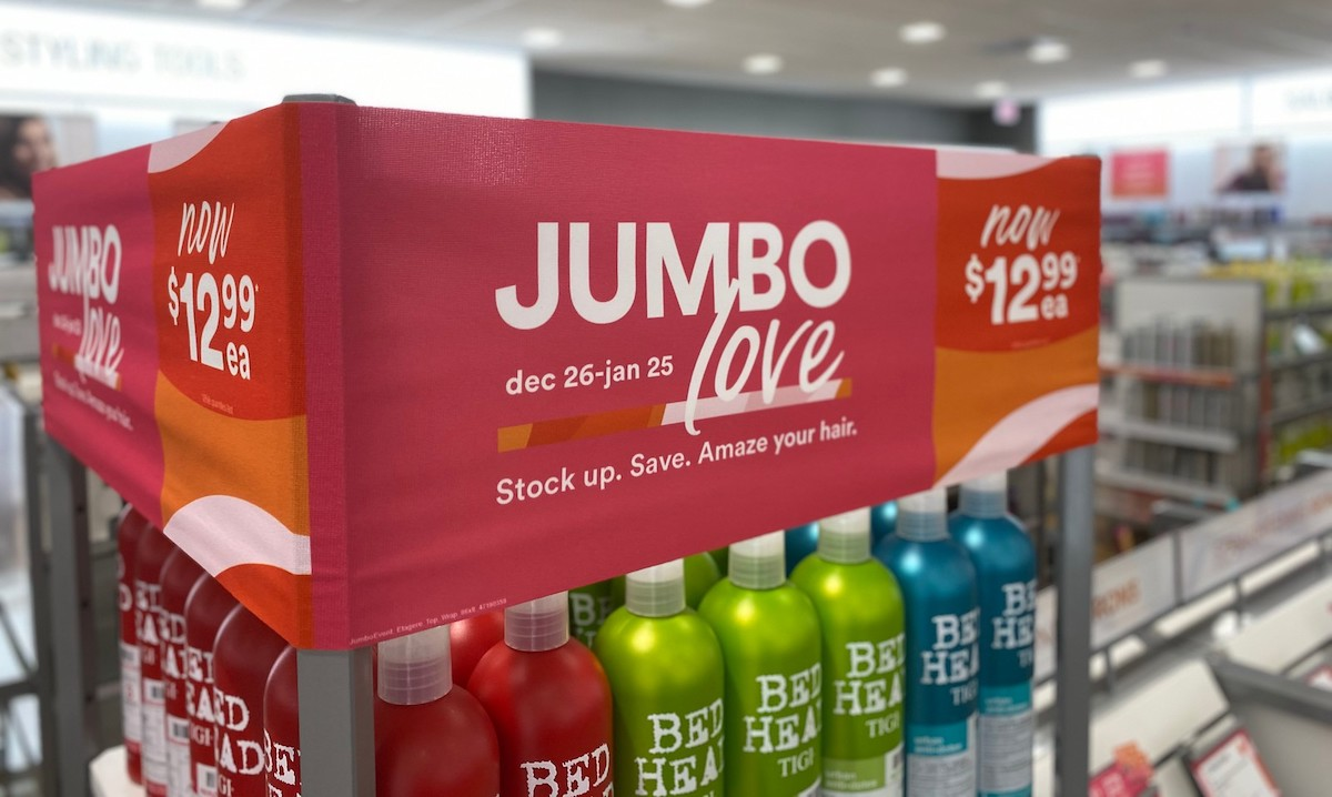 jumbo love ulta sale sign in store with red green and blue bed head hair care products