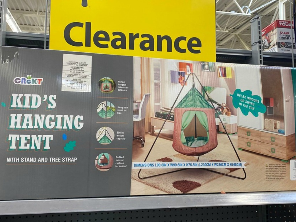 box with kids tent on shelf in store by clearance sign