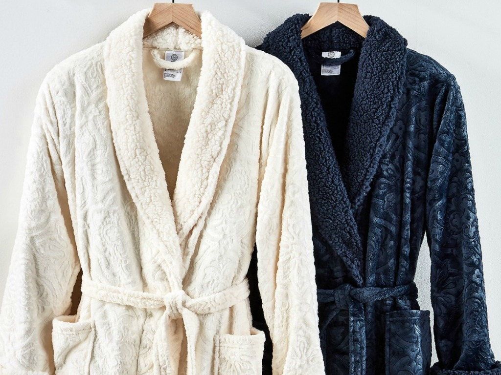 cream and navy blue robe on hangers