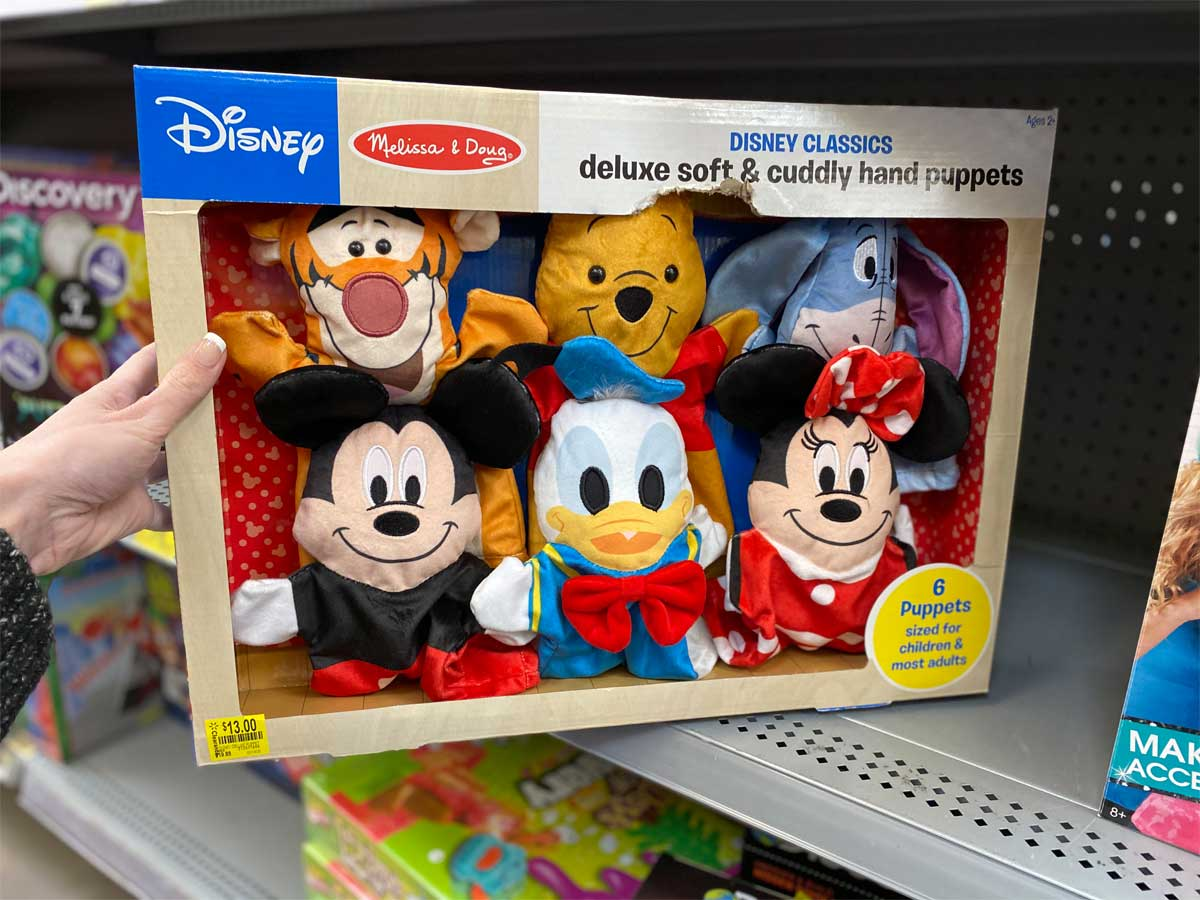 hand holding Melissa & Doug Disney Classics Deluxe Soft & Cuddly Hand Puppets, Set of 6