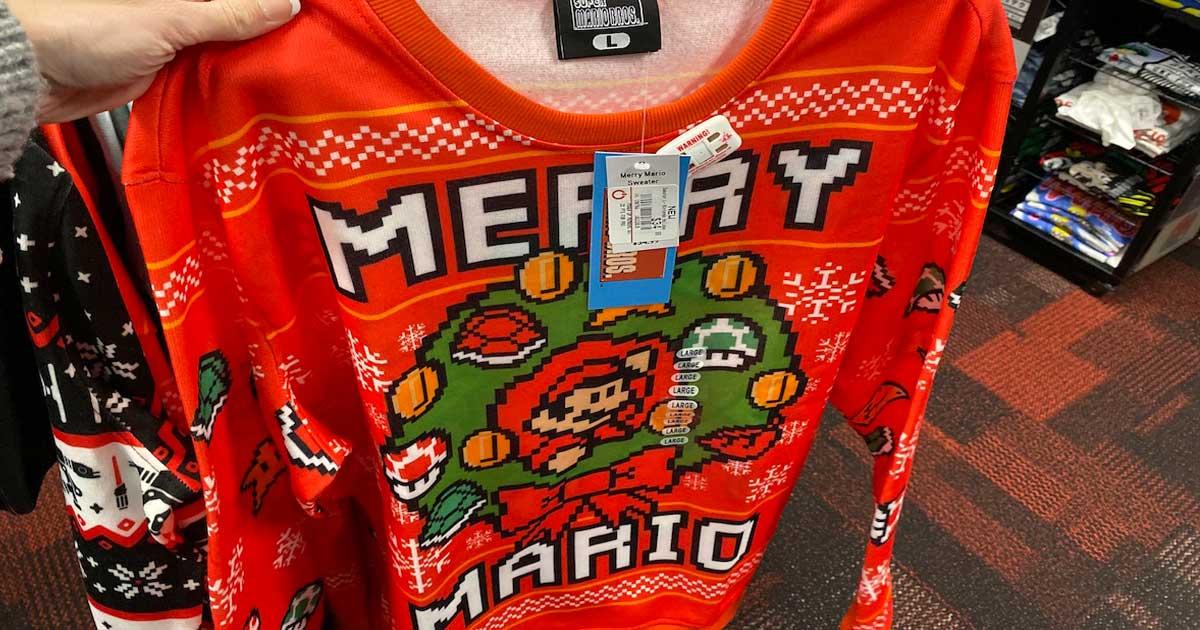 hand holding super mario bros merry mario sweater