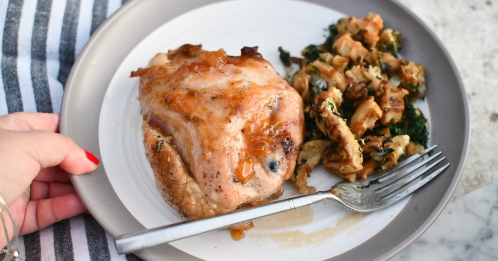 plate with savory peach roasted chicken and waffle stuffing