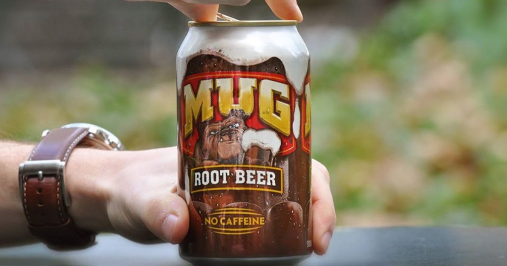 hand opening a can of mug rootbeer