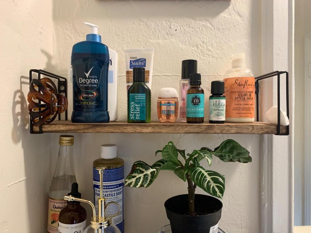 floating shelves in bathroom with personal care products