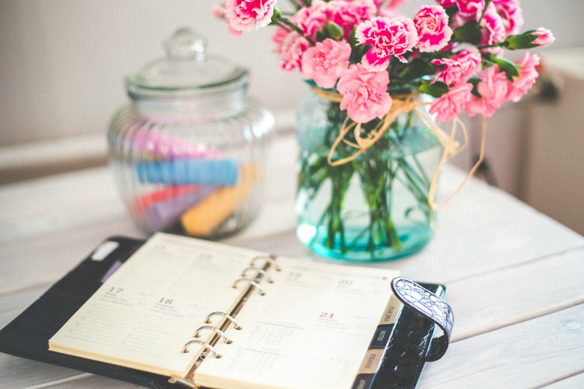planner on desk with flowers