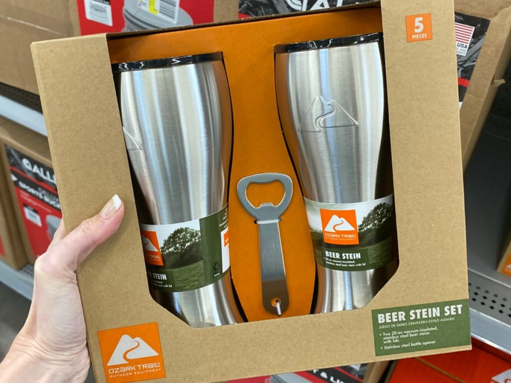 hand holding box with stainless cups