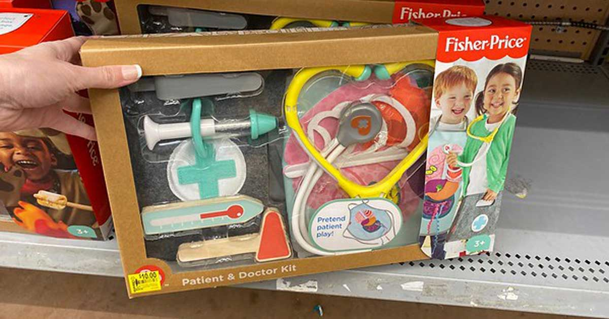 hand holding FIsher Price Patient and Doctor Kit