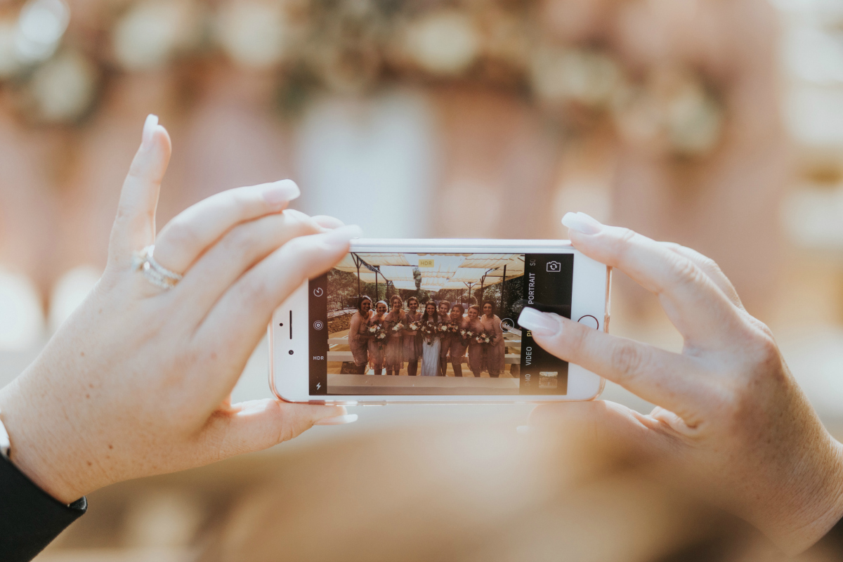 person taking wedding photos on iPhone