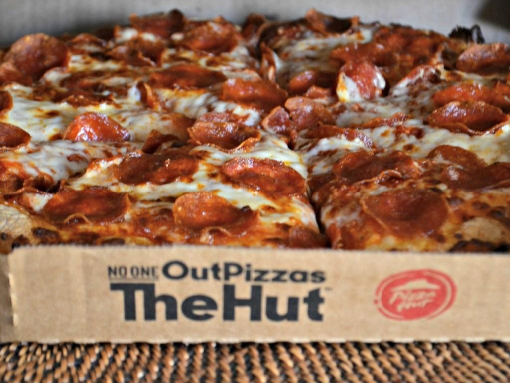 box with cheesy warm pizza inside