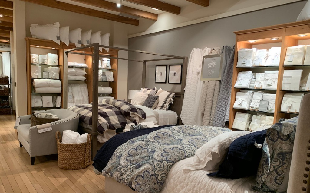 pottery barn store with beds and pillows