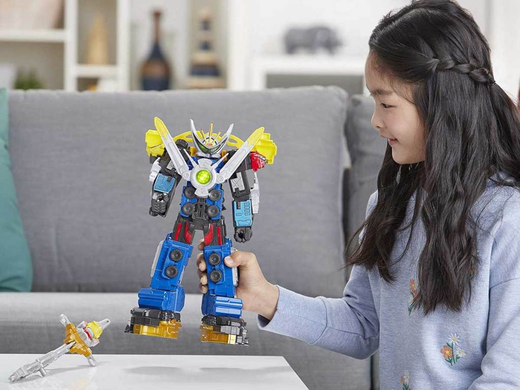 girl playing with Power Rangers Beast Morphers Beast-X Ultrazord Power Rangers Action Figure Toy