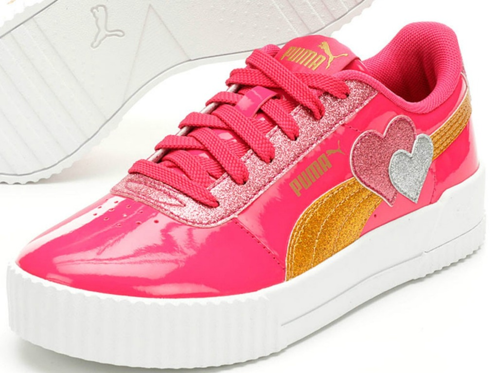 pair of pink sneakers with rainbow and hearts on it