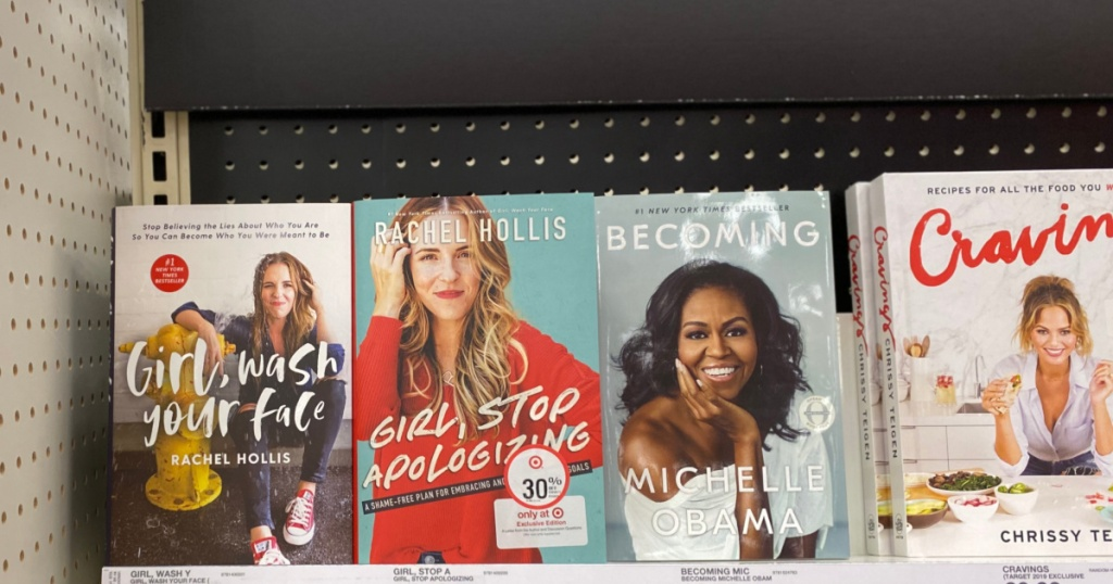 rachel hollis books and michelle obama's book on shelf in store