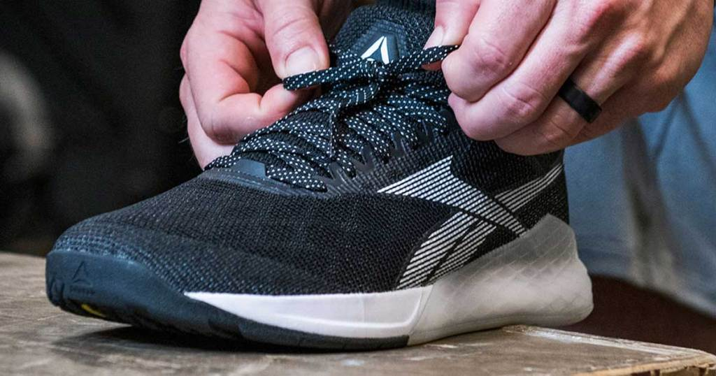 man tying the laces of his Reebok Men's Nano 9 Training Shoes