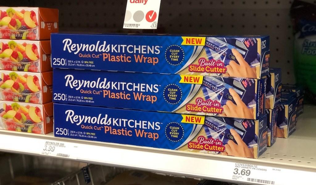 three boxes of reynolds plastic wrap sitting on store shelf