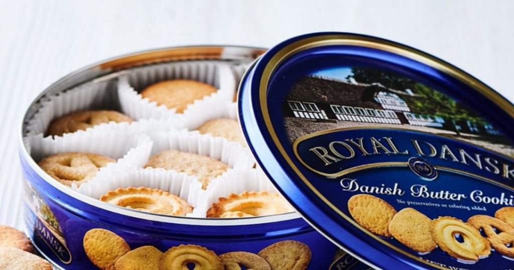 Open tin of Royal Dansk Cookies. Filled with cookies.