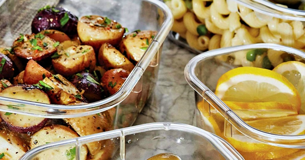containers with potatoes and lemon slices on table