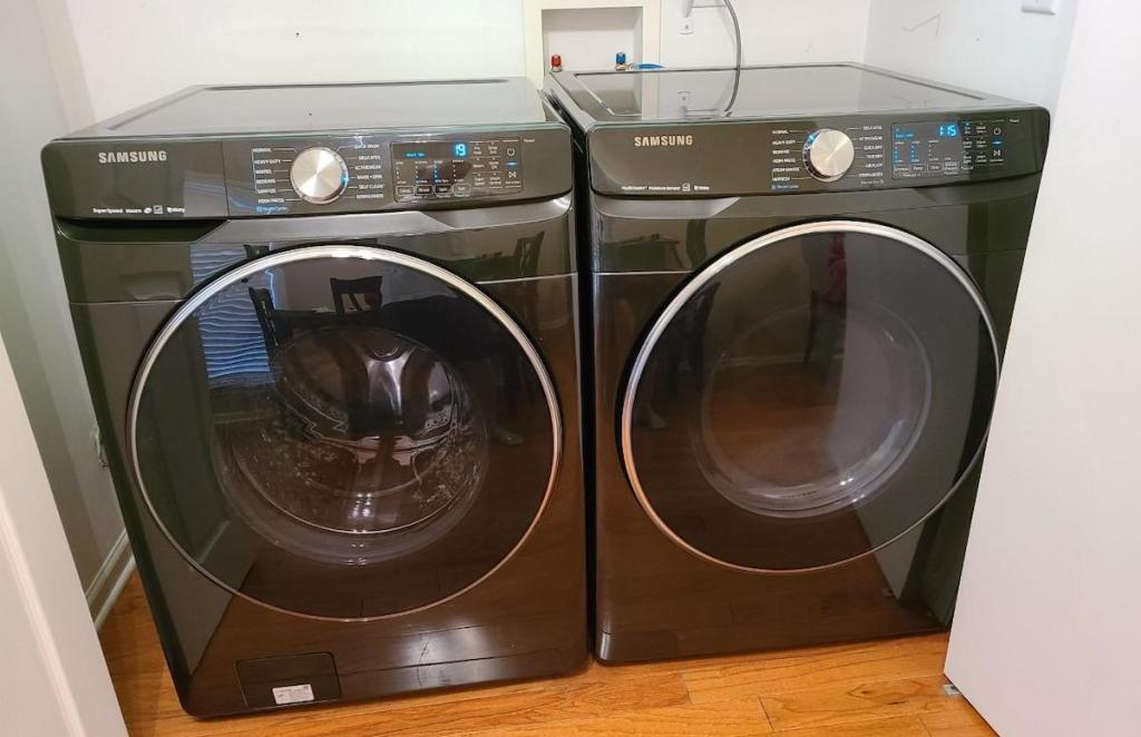 dark gray washer and dryer sitting in laundry room