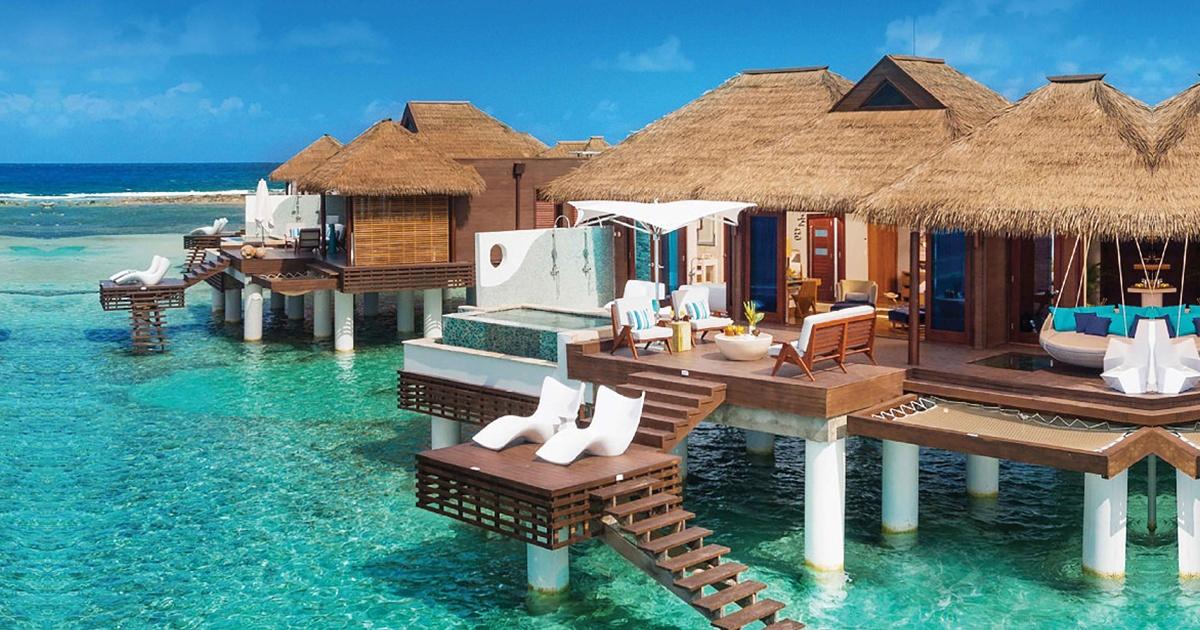 tiki huts on the ocean