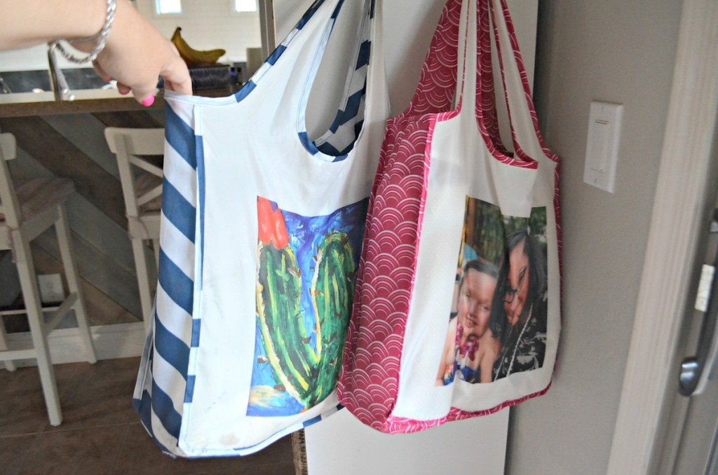hand holding reusable bag with cactus and family photo on it